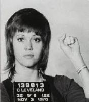 Jane Fonda's mug shot from 1970, where she is holding up her fist.